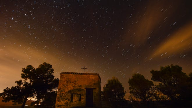 The Perseid meteor shower behind Arnotegui Hermitage in Obanos, Spain, Aug. 11, 2015.