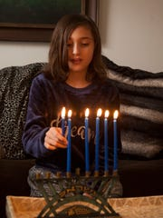 Cecilia Akrish discusses growing up with parents from different religions and blending holiday traditions Saturday, Dec. 16, 2017.
