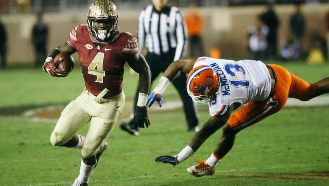 Dalvin Cook (4) runs the ball during the second half against the Florida Gators on Saturday, November 26, 2016. The Seminoles defeated the Gators 31-13.