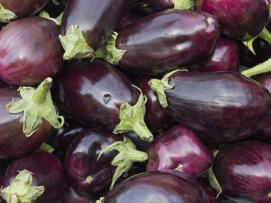 Eggplants can be round, oval or pear-shaped and may be white, purple or striped in color with a flesh that's firm and creamy white with a lot of edible white seeds in the center.