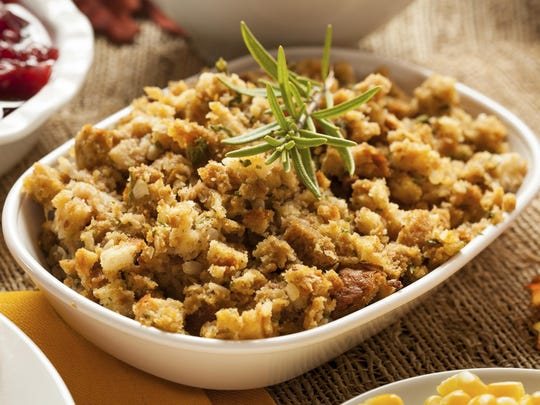 A 14-ounce box of dry stuffing mix makes about 10 servings.