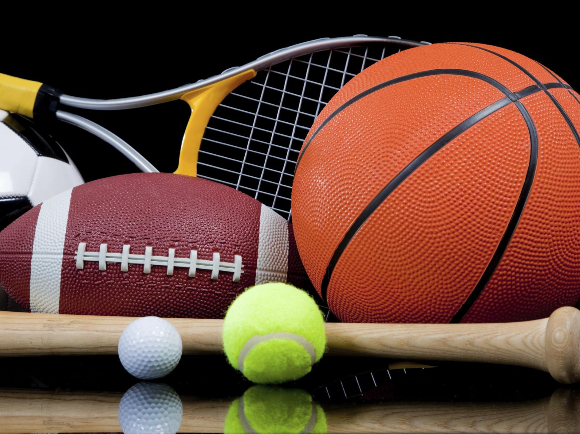 Assorted Sports Equipment on Black