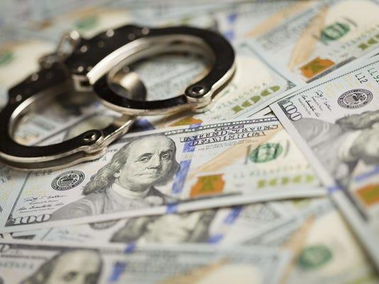 HandcuffsMoney187922075.jpg