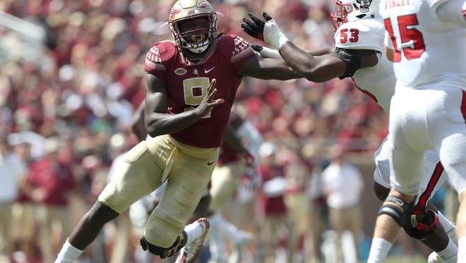 FSU's Josh Sweat tries to get to NC State's Ryan Finley during the Seminoles home opener at Doak Campbell Stadium on Saturday.