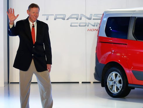 Alan Mulally, CEO of Ford Motor, wves to reporters during a press conference earlier this month