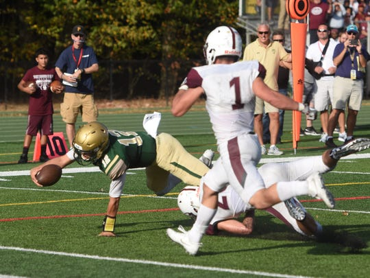 St. Joseph's Nick Patti (12) goes down near the goal line against Don Bosco on Saturday, Oct. 7, 2017. St. Joseph goes on to win the game.