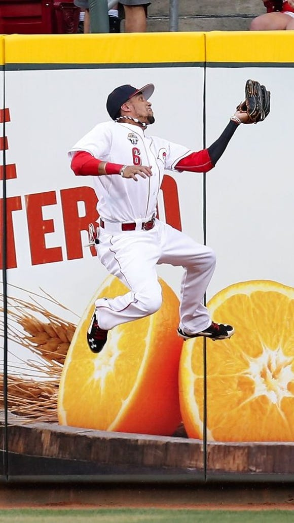 Billy Hamilton jumps for a fly ball hit by Ryan Braun Friday night.