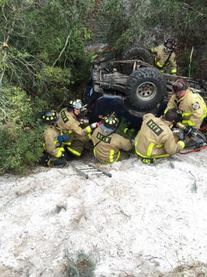 BCFR personnel rescue teens after a rollover crash into a canal in Sharpes.