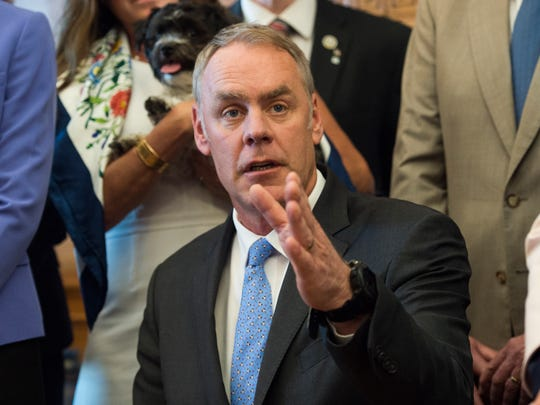 Interior Secretary Ryan Zinke speaks at the Interior Department in Washington, Wednesday, March 29, 2017, after signing an order lifting a moratorium on new coal leases on federal lands and a related order on coal royalties.