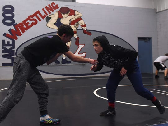 Lakewood junior Kailiena Allen, sparring with her brother