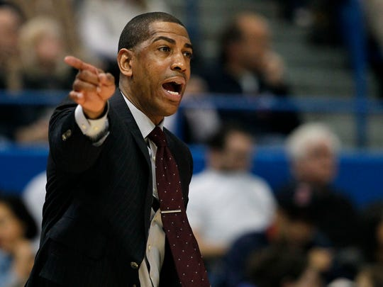 Former UConn head coach Kevin Ollie directs his team against the UC Bearcats in 2017.