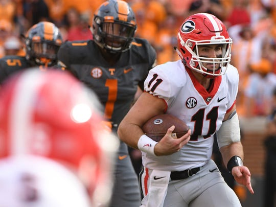 Georgia quarterback Jake Fromm (11) runs against the Vols defense Saturday, Sept. 30, 2017.