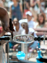 Spectators watch a hot glass demonstration during the