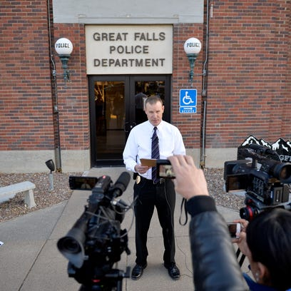 Great Falls Police Chief David Bowen reads a prepared