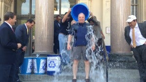 Senate President Stephen Sweeney gets a bucket of ice water poured over him as part of an ALS Association fundraiser. (Michael Symons/Asbury Park Press)