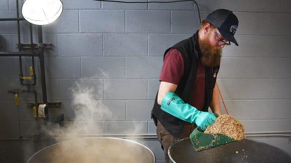 Brewmaster John Berknes brews at Monk's Tuesday, Dec.
