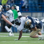 Alex Singleton of Montana State makes a tackle last November in Bozeman.