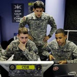 U.S. Military Academy cadets watch data on a computer Wednesday at the Cyber Research Center at West Point, N.Y. The cadets are fending off cyber attacks this week as part of an exercise involving all the service academies.