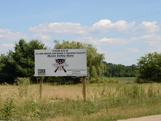 A sign along Milford Road near I-96 at the site where Huron Valley Guns will soon break ground on a new shop and indoor gun range facility.