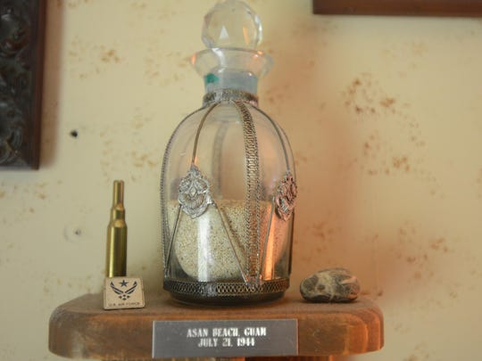 This bottle contains sand taken from Asan Beach at Guam in the South Pacific, where Robert Goodson landed with the 3rd Marine Division on July 21, 1944.