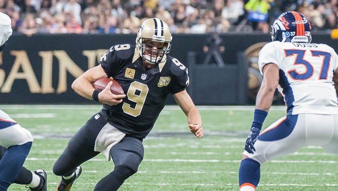 Saints quarterback Drew Brees (9) slides to prevent getting hit by Denver Broncos cornerback Lorenzo Doss (37) on Sunday November 13, 2016.