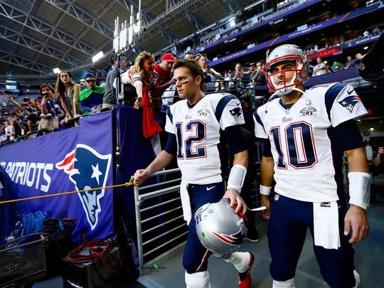Tom Brady #12 and  Jimmy Garoppolo #10 of the New