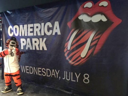 Detroit Tigers mascot Paws poses with a Rolling Stones concert banner at Comerica Park on Tuesday, March 31.
