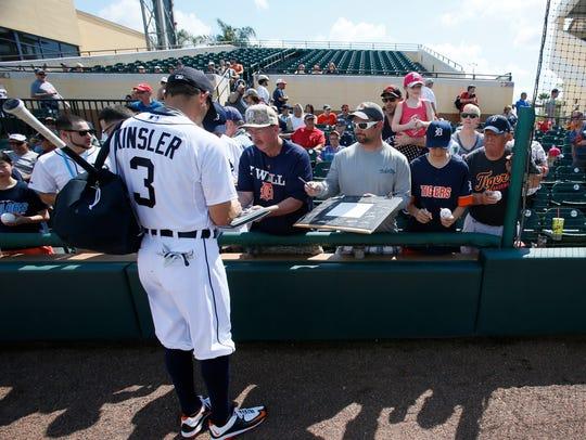 Detroit Tigers second baseman Ian Kinsler signs autographs
