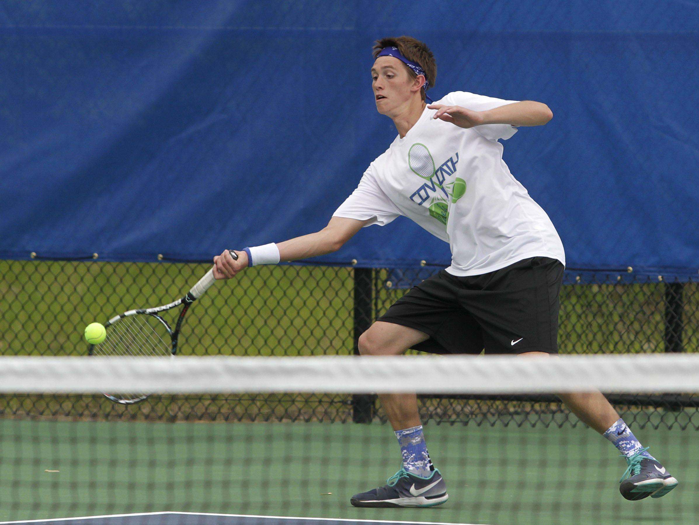 Covington Catholic's Austin Hussey won his fourth straight regional tennis title on Tuesday.
