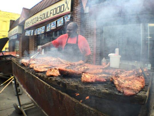 Chef Mark Dearing barbecues ribs outside Bert's near Eastern Market on June 12, 2015.