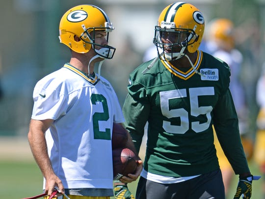 Green Bay Packers kicker Mason Crosby and linebacker Andy Mulumba talk during minicamp at Clarke Hinkle Field.