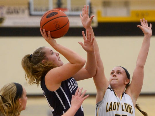 Dallastown's Sabrina Stough shoots over Red Lion's Courtney Dimoff, right, and Hannah Wolf during Tuesday's girls' basketball game at Red Lion Area High School.