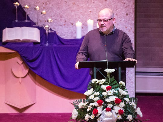 Chapel Hill United Methodist Church Rev. Chad Parmalee spoke of love and forgiveness at a community prayer service on Thursday commemorating the victims and survivors of last weekend's Kalamazoo shootings.