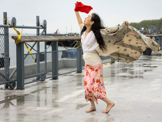 Japanese-dancer Eiko performs Friday outside the Moran Plant in Burlington.