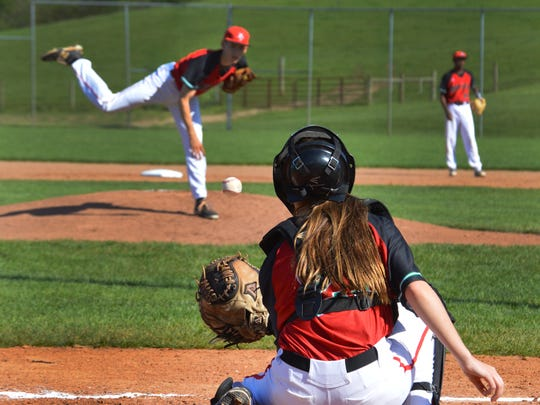 Park Tudor varsity baseball recently fielded a unique pitcher-catcher pair as Jennifer Oberthur caught her brother, Colin during a regular season game.