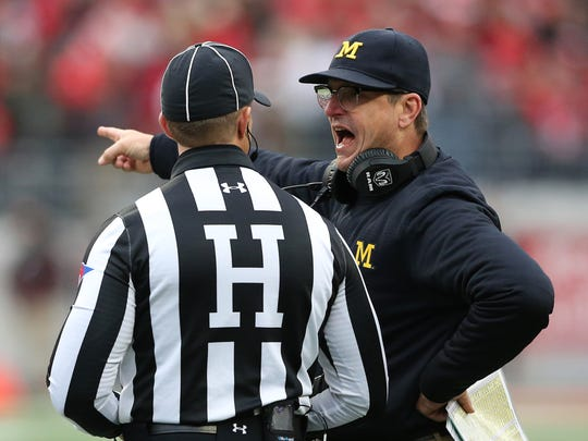 Nov 26, 2016; Columbus, OH, USA; Michigan Wolverines head coach Jim Harbaugh discusses a call with the referee during the third quarter against the Ohio State Buckeyes at Ohio Stadium.