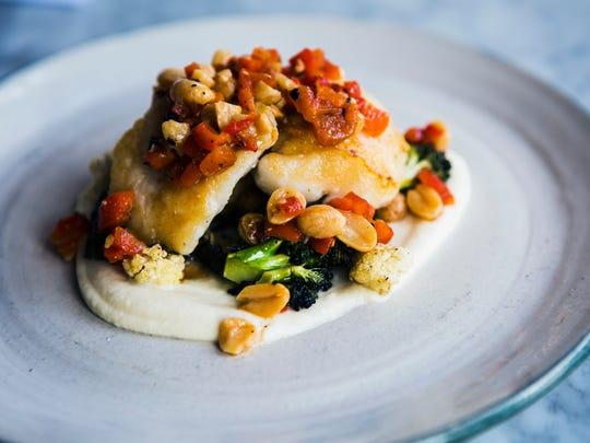 January 25, 2017 - The monkfish dish at Andrew Michael Italian Kitchen features celery root, peanut romesco, broccoli, cauliflower and fall misticauza. The restaurant is located at 712 West Brookhaven Circle.