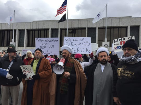 Imam Mohammad Elahi, leader of the Islamic House of Wisdom in Dearborn Heights addresses the crowd in front of the Henry Ford Centennial Library in Dearborn, Sunday, Jan. 29, 2019.