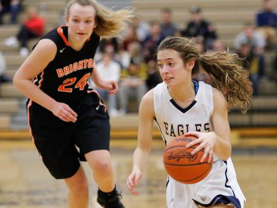 Hartland's Michelle Moraitis handles the basketball