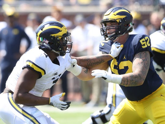 Michigan defensive end Rashan Gary rushes against offensive