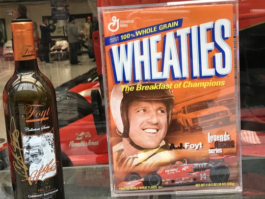 A display showing race car legend A.J. Foyt on the box of Wheaties and a bottle of his family's wine at the Indianapolis Motor Speedway's Hall of Fame on Thursday, May 25, 2017.