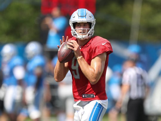 Lions quarterback Matthew Stafford goes through passing