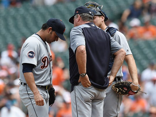 Tigers starting pitcher Anibal Sanchez, left, talks with catcher John Hicks and pitching coach Rich Dubee after giving up three home runs to the Orioles in the first inning Sunday, Aug. 6, 2017 in Baltimore.