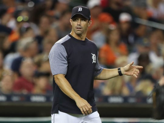 Tigers manager Brad Ausmus goes to the mound to take