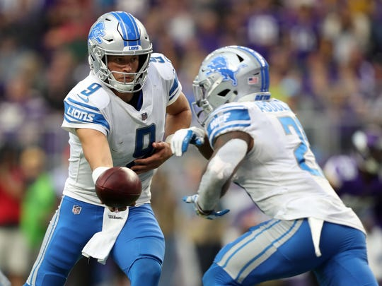 Oct 1, 2017; Minneapolis, MN, USA; Lions quarterback Matthew Stafford hands the ball to Ameer Abdullah in the fourth quarter at U.S. Bank Stadium.