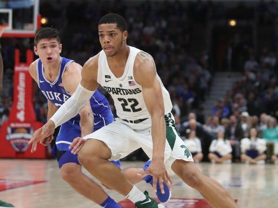Michigan State's Miles Bridges drives against Duke's