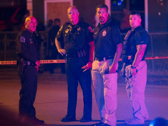 Fort Myers Police officers investigate a fatal shooting on Tuesday in Fort Myers. The shooting occurred in front of a home on Zana Drive, in the Campbell Acres neighborhood, which is located behind the Penny Saver Supermarket off Ortiz Avenue.