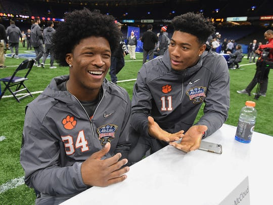 Clemson wide receiver Ray-Ray McCloud, left, and wide