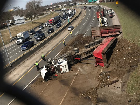 Crews work to clear the scene where a semi overturned