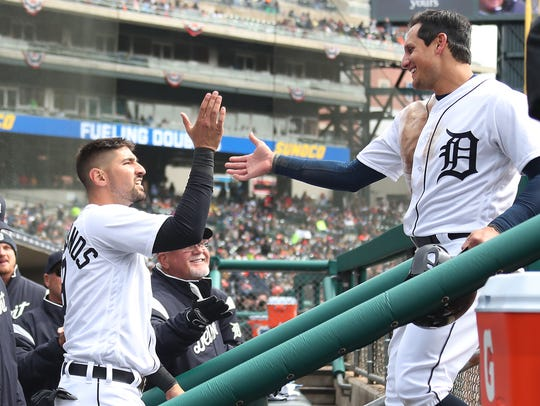 Tigers right fielder Nicholas Castellanos high-fives